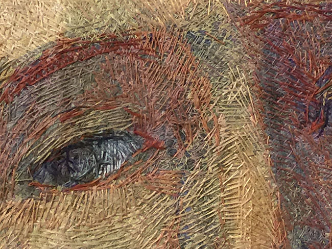 """Detail of hand-stitched eye from """"Encounter"""" by Audrey Walker 1998."""