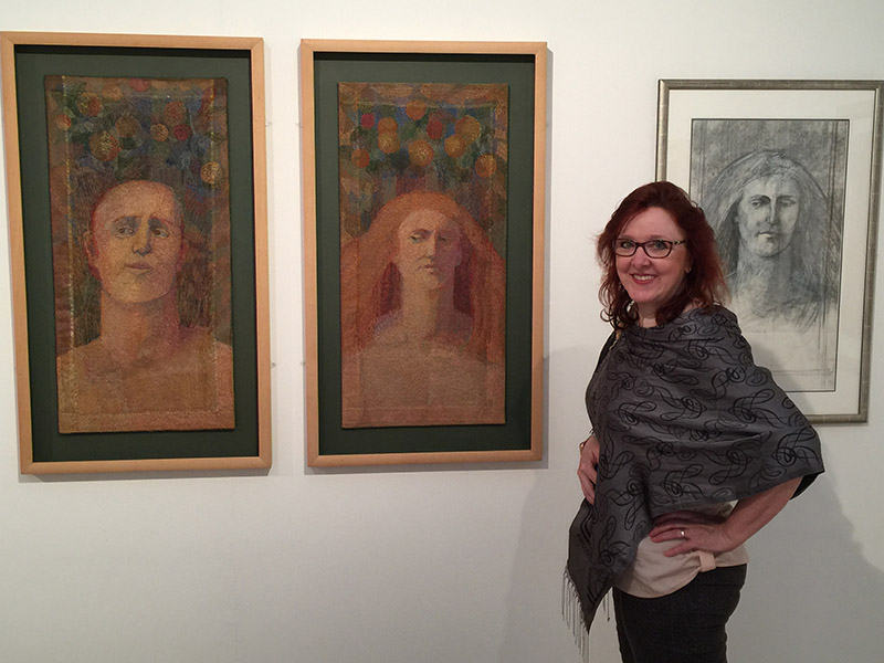 """Christina Fairley Erickson with Audrey Walker's """"Adam"""" and """"Eve"""" stitched textiles (2000) and drawing study for """"Eve""""."""