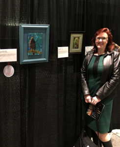 """Christina with her """"Crested Serpent Eagle"""" -2nd Place for Fiber Arts-Needlework and her piece """"Fern Frond"""""""