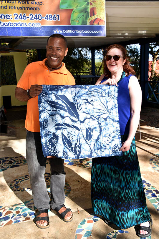 Christina Fairley Erickson and Henderson Reece with the completed and dried practice batik piece