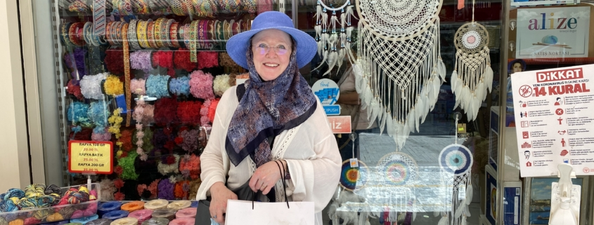 Christina Fairley Erickson in front of Istanbul embroidery store