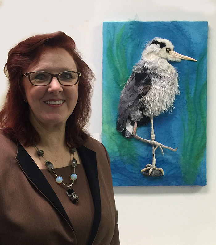 "Christina's large-scale wall piece is a 3D Stumpwork heron, ""Focused Intent"""