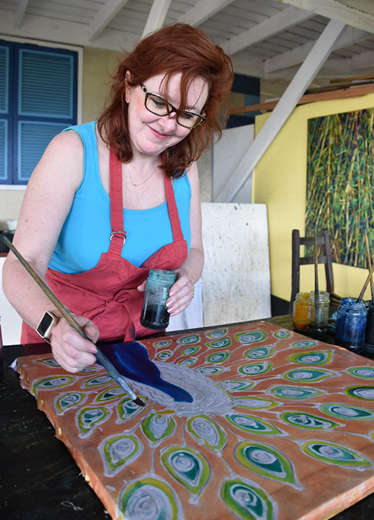 Painting dye into the peacock and feathers - Christina Erickson batik